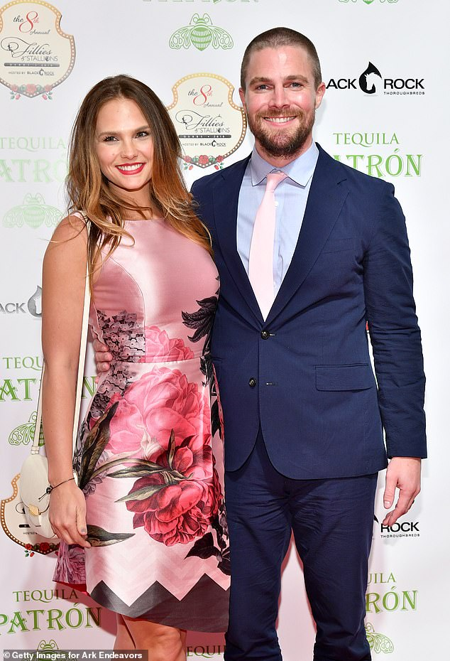 Trouble: Arrow star Stephen Amell responded to reports that he was 'forcibly removed' from a flight after a shouting match with his wife, Cassandra Jean; seen in 2018