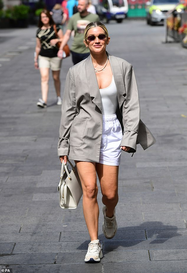 Out and about:Ashley Roberts was back to her regular routine as she departed Global Studios in London on Tuesday after co-hosting her Heart Radio breakfast show