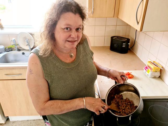 Alison Palmer with food she has made for her YouTube channel 'cooking on benefits'. A savvy mum reveals the shopping and cooking hacks that enable her to cook meals for her family for as little - as 75p. See SWNS story SWSYbenefits. Mum-of-one Alison Palmer, 48, set up a YouTube channel to show people how to cook ?proper food? - even when money is tight. She learned ?proper cooking? from a young age after watching her mother cook fresh, home-made meals despite the family being strapped for cash. Now on benefits herself, Alison cooks a wide range of budget-friendly meals for her and husband Barry Preest, 42. She began filming the process to show it doesn't have to cost the earth. Her top tips include using tinned or frozen veg, shopping for the budget own brands, planning out all your meals before you shop, and hitting the end of day reduced section. Her meals include tasty family favourites such as toad in the hole, chilli con carne and even Cornish pasties - and costs per portion can be as low as 75p thanks to her savvy food shopping habits.