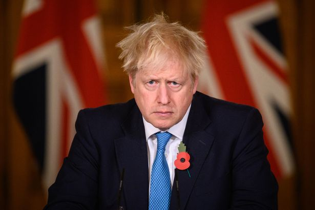 UK Prime Minister Boris Johnson answers questions during a briefing on the current coronavirus pandemic, in Downing Street on November 5, 2020