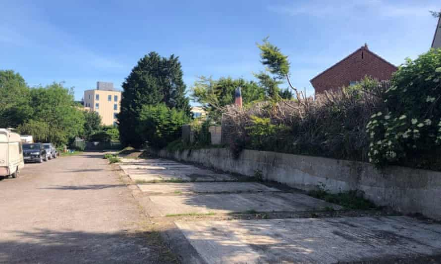 An old garage site in Horfield, Bristol, where the first 'gap homes' are to be built