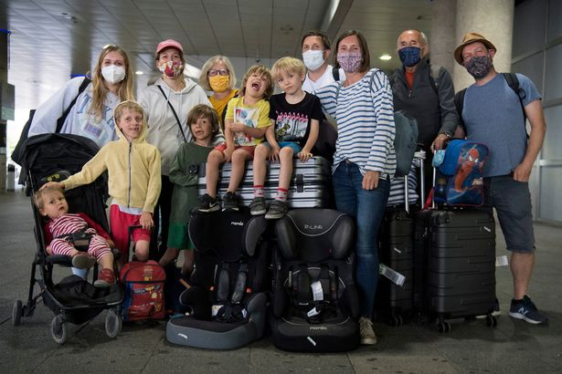 The Webster Family, who live in Beckenham and Chichester, at Gatwick Airport, West Sussex, after returning on a flight from Faro in Portugal