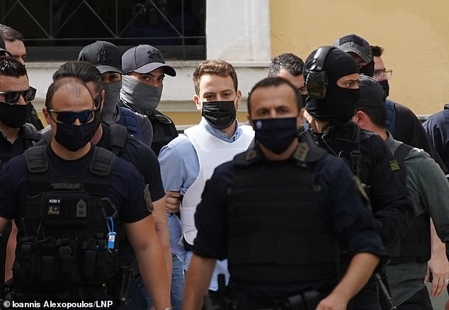 Babis Anagnostopoulos pictured arriving at court on Tuesday where he recounted a confession he gave to police last week that he smothered wife Caroline Crouch to death
