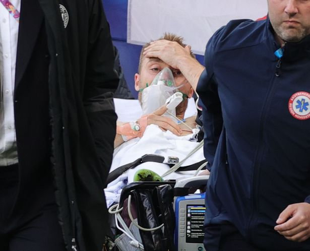 Christian Eriksen is taken from the field on a stretcher