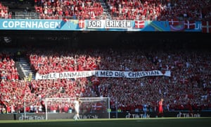 Denmark supporters display a banner for Christian Eriksen, the Danish player who collapsed during the match against Finland last Saturday, June 12, during the Euro 2020 soccer championship group B match between Denmark and Belgium, at the Parken stadium in Copenhagen, Thursday, June 17, 2021. (Wolfgang Rattay, Pool via AP)