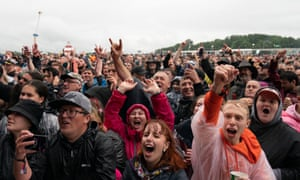 Festivalgoers on the first day of the Download festival at Donington Park, Leicestershire, on Friday