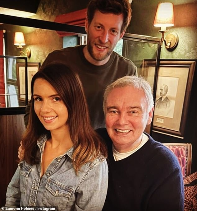 Happy news: Eamonn Holmes shared this rare snap with daughter Rebecca Holmes, 30, and her fiancé Mark (all pictured) to Instagram on Thursday, as they celebrated her engagement