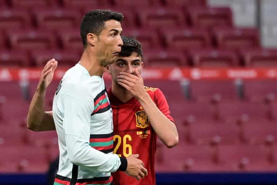Pedri with Cristiano Ronaldo during their friendly.