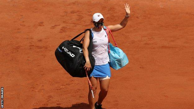 Ashleigh Barty waves as she leaves the court