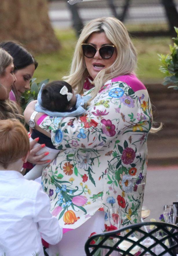 Gemma Collins holds baby