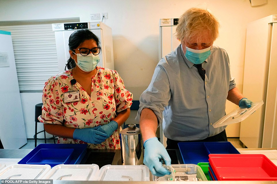 Boris Johnson all but ruled out summer holidays today as he admitted foreign travel this year will be 'difficult' – despite No10 drawing up plans to scrap travel quarantine rules for double-jabbed Britons. Mr Johnson made the comments during a visit toa Covid-19 vaccination centre temporarily set up at StoneX Stadium, home of English rugby union club Saracens, in north London today
