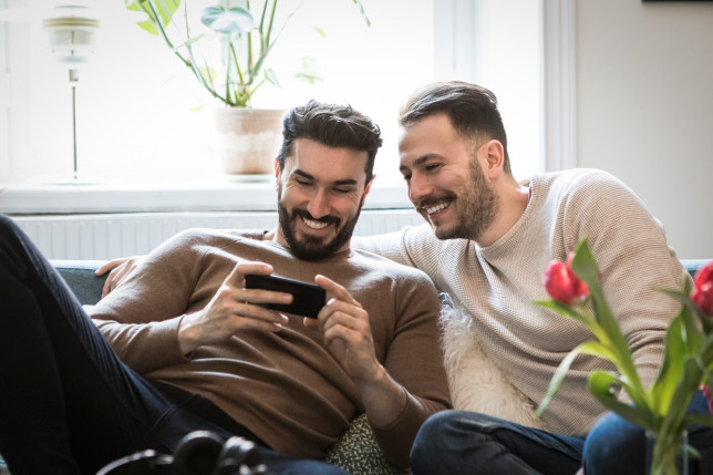 a couple laughing at a phone