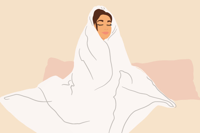 Woman covered with a blanket at home