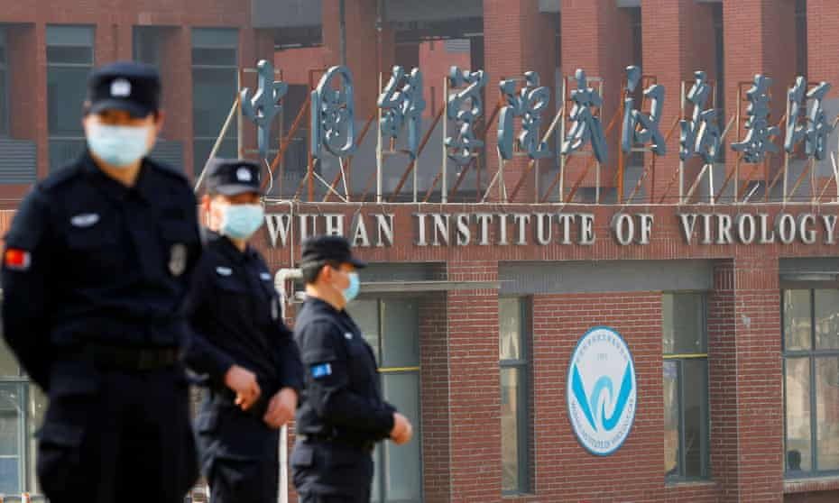 Security personnel keep watch outside the Wuhan Institute of Virology during a visit by WHO investigators on 3 February 2021