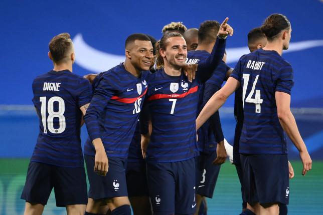 Antoine Griezmann and Kylian Mbappe celebrate