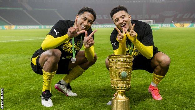 Jadon Sancho (right) and England team-mate Jude Bellingham helped Borussia Dortmund win the German Cup final in May
