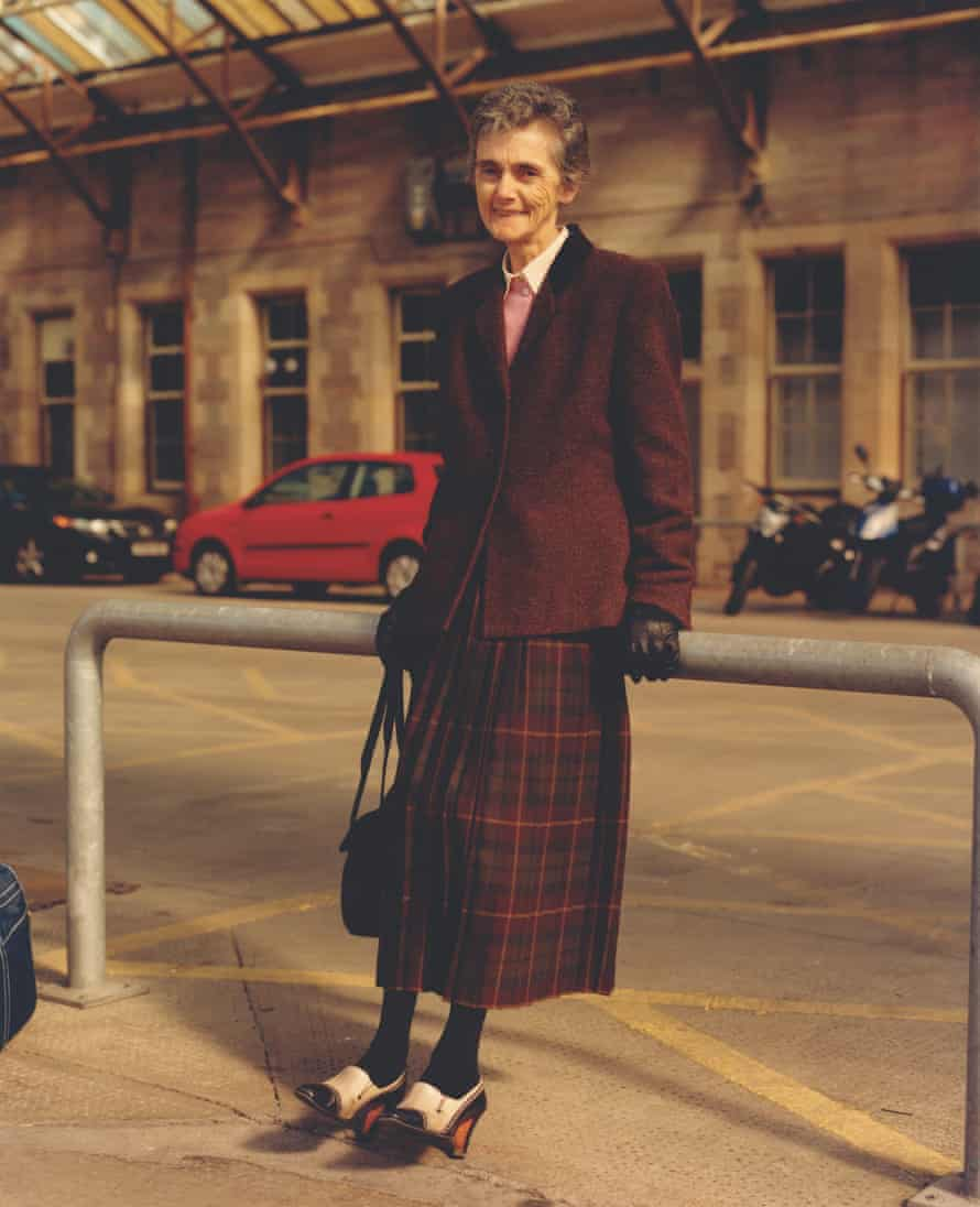 Image from The British Isles by Jamie Hawkesworth of an older woman leaning against a bike rack.