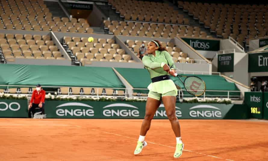 Serena Williams prepares to play a backhand during her straight-sets win over Irina-Camelia Begu with an empty stand behind her
