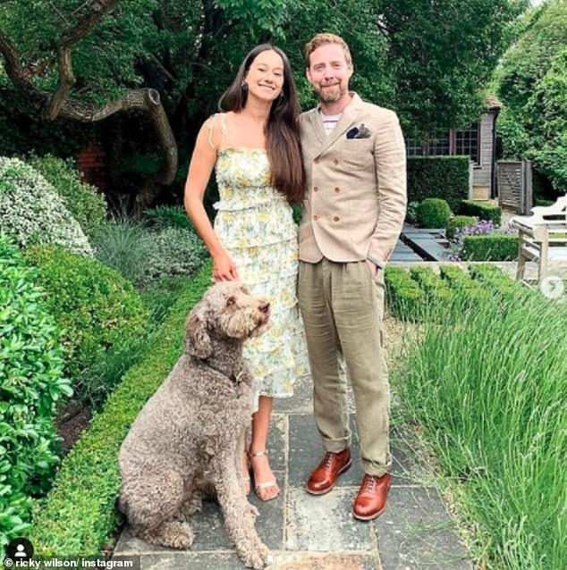 Newly-weds:Ricky Wilson and his new wife Grace Zito have revealed they are planning a 'huge party' after their scaled-back wedding due to the coronavirus pandemic (pictured on their honeymoon inBerkshire with pet dogReedus)