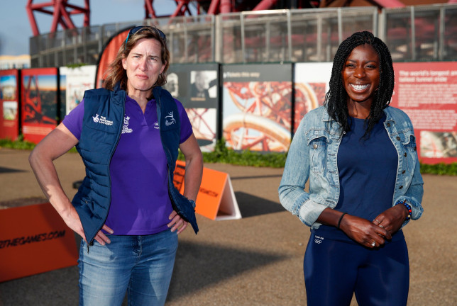 LONDON, ENGLAND - JUNE 03: (L-R) Dame Katherine Grainger and Olympian Christine Ohuruogu talk to Badu Sports athletes during the media launch of From Home 2 the Games at Queen Elizabeth Olympic Park on June 03, 2021 in London, England. From Home to the Games is a Talent ID programme for Olympic and Paralympic Athletes of the future. (Photo by Luke Walker/Getty Images for UK Sport)