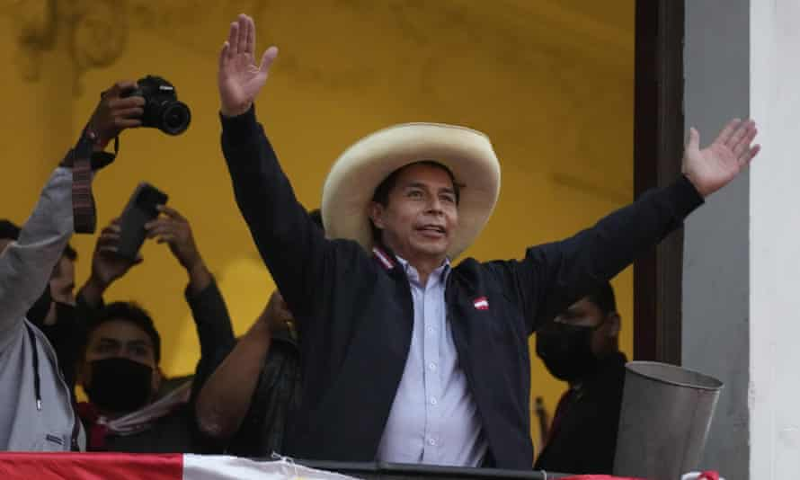 Presidential candidate Pedro Castillo greets supporters celebrating partial election results that show him leading over Keiko Fujimori
