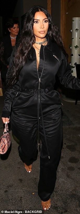 Kim Kardashian, seen here in LA on Friday night, has said talking about her sex tape in the first-ever series of KUWTK helped her 'deal' with her emotions