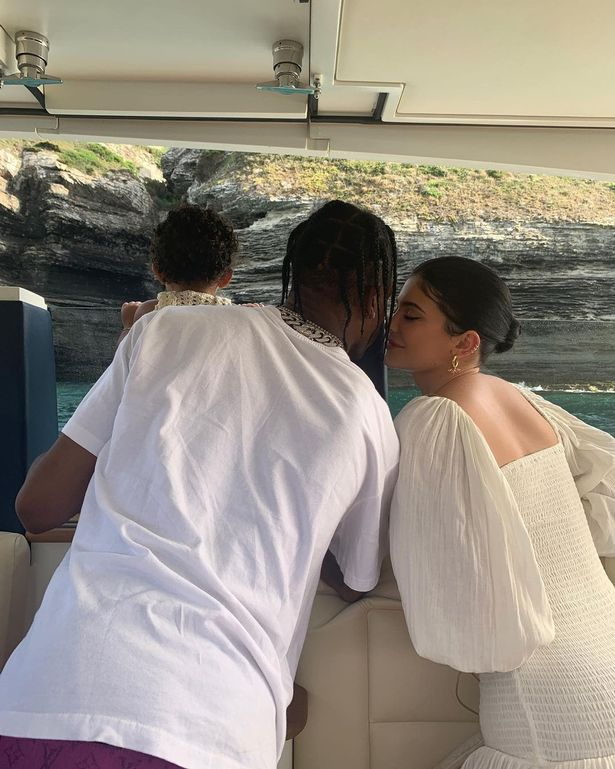 Travis Scott cosies up with Kylie Jenner and their daughter Stormi