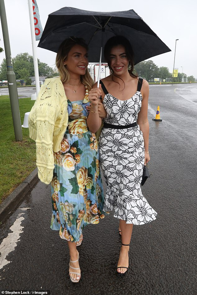 Stunning:Francesca Allen put on a typically chic display on Friday in a figure-hugging floral dress as she braved the rain for Ladies' Day at Epsom Downs Racecourse in Surrey