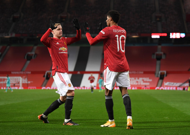 Donny van de Beek and Marcus Rashford high five during Manchester United's FA Cup clash with Liverpool