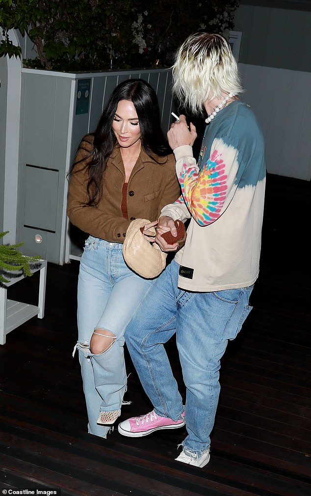 Sweet: Megan Fox looked smitten with beau Machine Gun Kelly as they held hands while making a stylish entrance at glitzy PrettyLittleThing x Galore magazine bash on Thursday