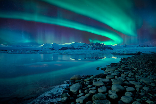 The Northern Lights over a glacier lagoon in Iceland (William Yu/Getty Images)