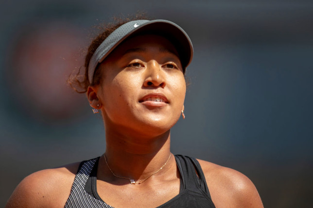 Naomi Osaka looks on at the French Open