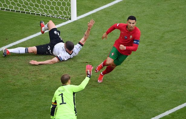 Cristiano Ronaldo (R) of Portugal celebrates after scoring the 1-0 goal during the UEFA EURO 2020 group F preliminary round soccer match between Portugal and Germany