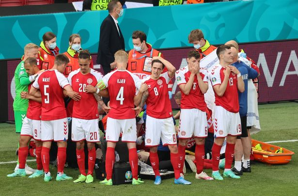 Denmark players formed a protective ring around teammate Christian Eriksen after his sudden collapse
