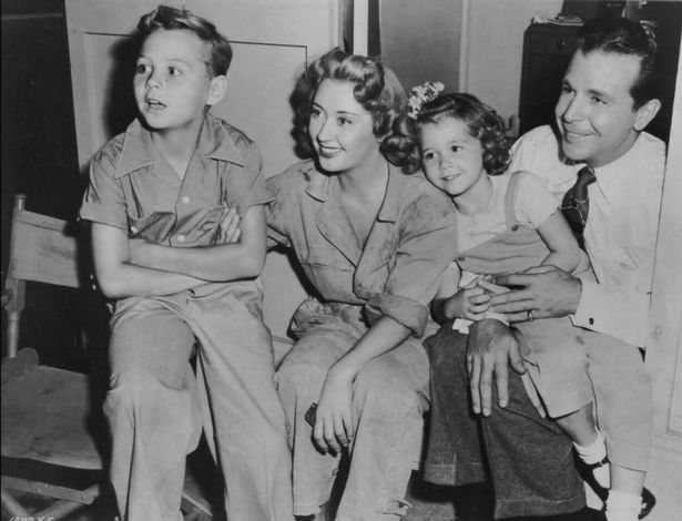 Joan Blondell, Dick Powell, Ellen Powell, and Norman S. Powell