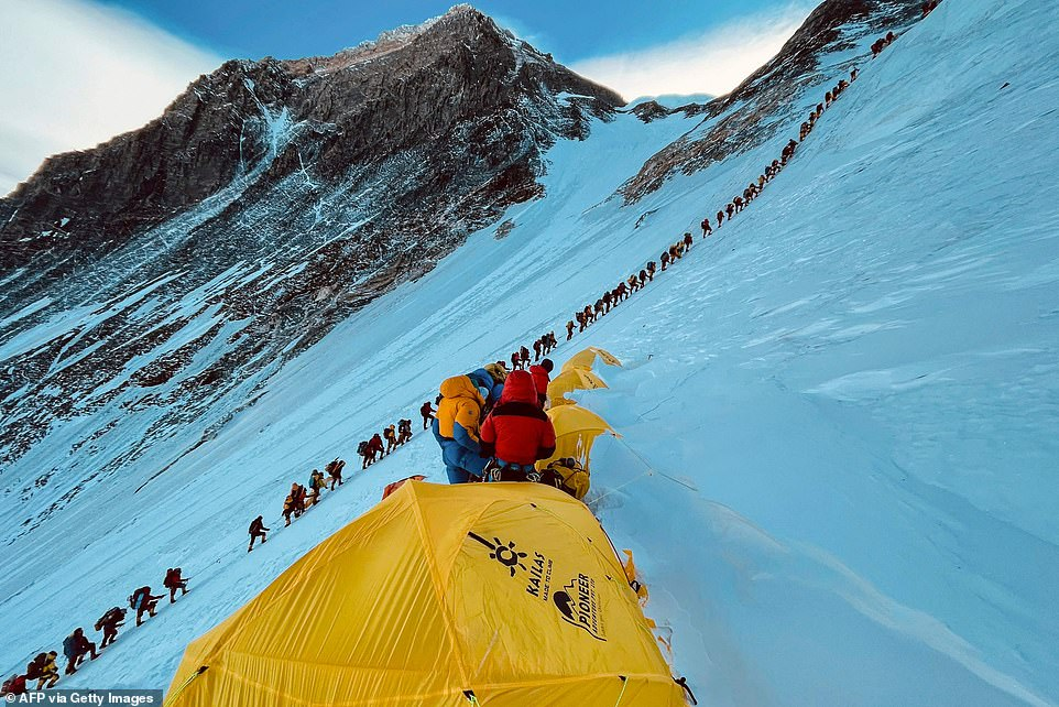 Mountaineers lined up in a huge queue as they approach the summit on May 31. Mount Everest has issued a record number of permits, worth around £3 million, after last year's peak season was ruined by coronavirus