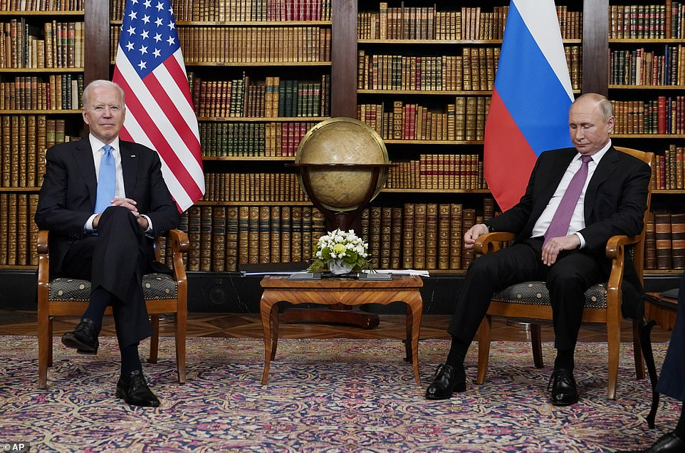 Putin looks down at the floor during an awkward first moment with Biden ahead of five hours of gruelling chat to help salvage relations between Moscow and Washington
