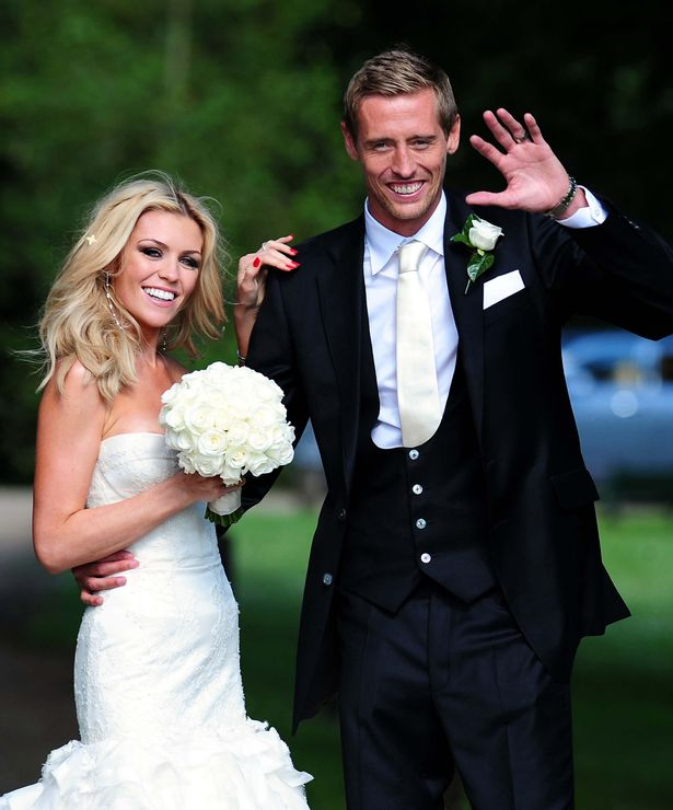 Footballer Peter Crouch and model Abbey Clancy in the grounds of Stapleford Park in Leicester following their wedding in 30/06/2011