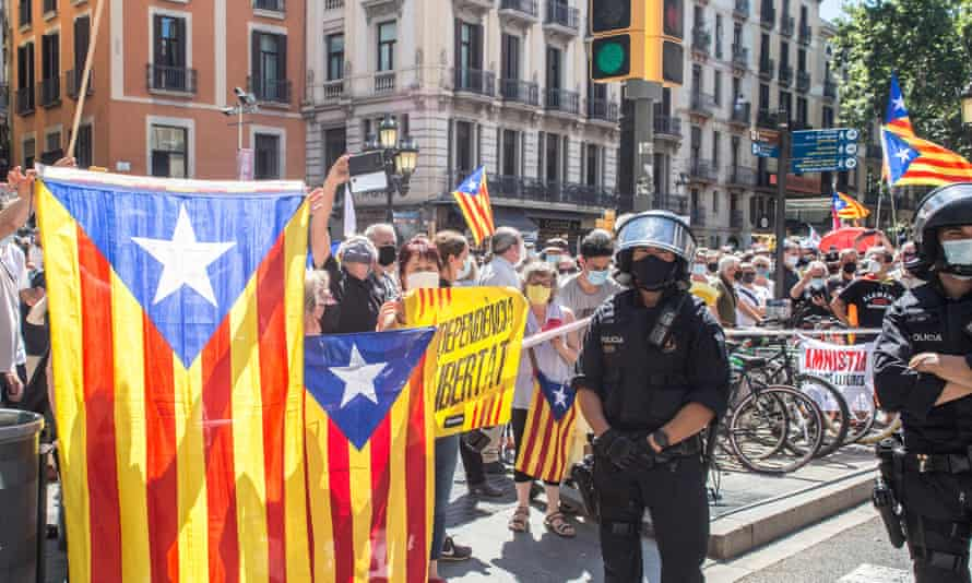 Protesters with Catalan flags gather outside the opera house in Barcelona