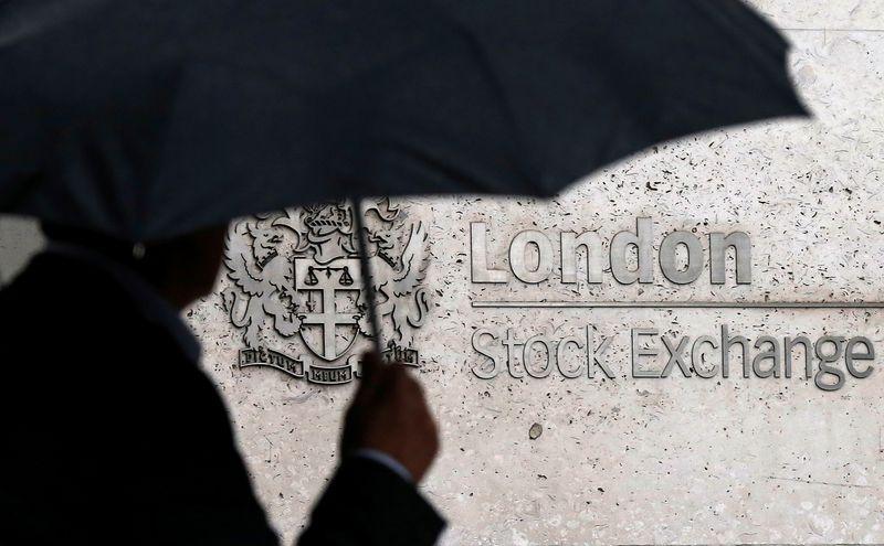 Strong earnings pull British shares higher; Aviva climbs