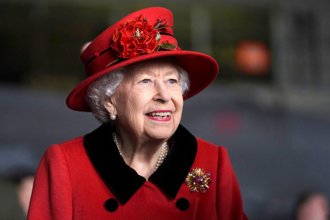 Britain's Queen Elizabeth II reacts during her visit to the aircraft carrier HMS Queen Elizabeth in Portsmouth, southern England on May 22, 2021, ahead of its maiden operational deployment to the Philippine Sea. - The aircraft carrier will embark on her first operational deployment on May 23, leading the UK Carrier Strike Group in engagements with 40 nations including India, Japan, Republic of Korea and Singapore. (Photo by Steve Parsons / POOL / AFP) (Photo by STEVE PARSONS/POOL/AFP via Getty Images)