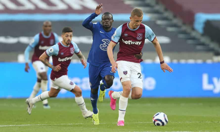 Soucek battles with Chelsea's N'Golo Kanté in the Premier League. He has been crucial to West Ham's rise this season.