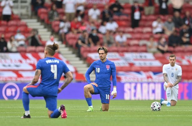 England players take the knee ahead of a friendly match against Romania