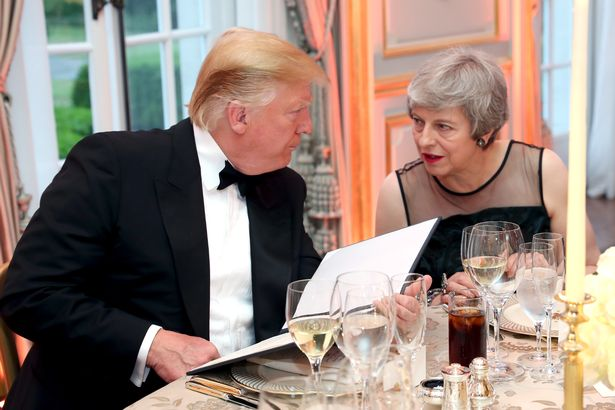 US President Donald Trump and British Prime Minister Theresa May speak at a dinner hosted by himself and First Lady Melania Trump at Winfield House for Prince Charles