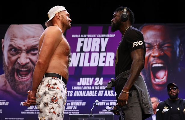 WBC Heavyweight Champion Tyson Fury (L) and Deontay Wilder (R) face-off during the press conference for the WBC heavyweight championship at The Novo by Microsoft at L.A. Live on June 15, 2021 in Los Angeles, California