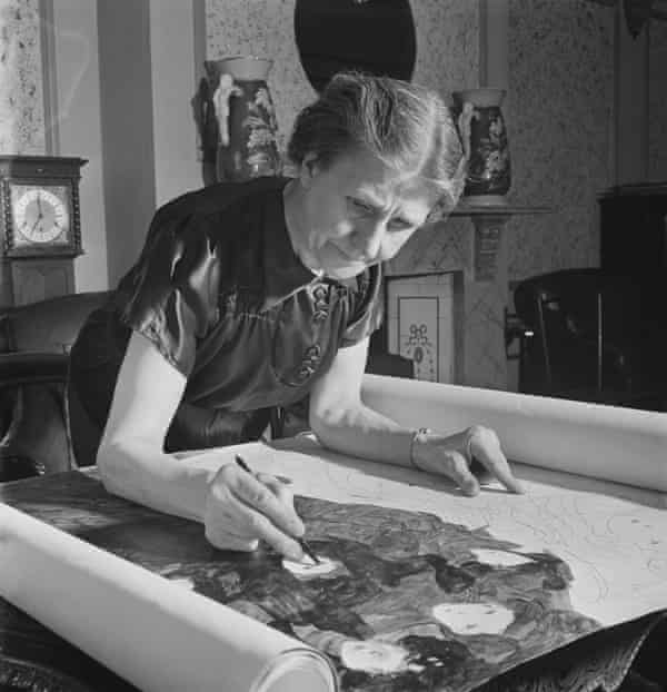 Madge Gill working on a section of a large pen and ink piece on fabric at her home in East Ham, London, on 19 August 1947.