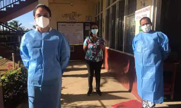 Masked nurse Sharon Zibran, left, with two masked colleagues in Nakasi
