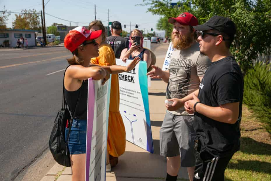 Members of the pro-choice group We Engage argue with members of Operation Save America outside Camelback Family Planning.