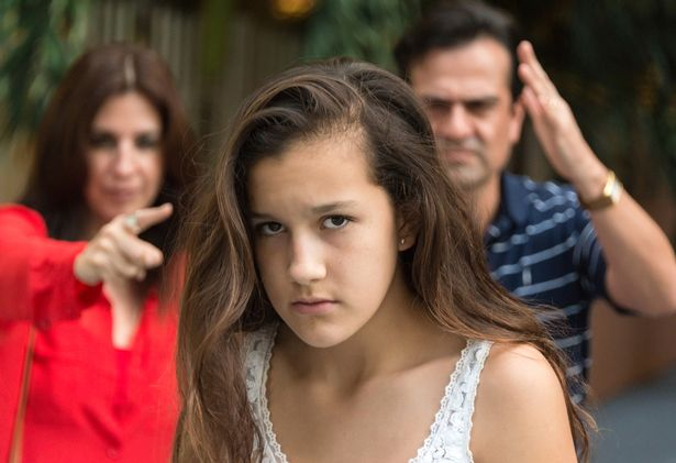 Teenage girl getting yelled at by parents
