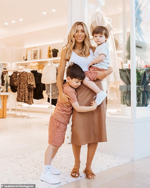 Keeping mum: Nadia is a single mother to sons Aston, five, and Henley - both of whom she shares with ex-husband Jimmy Bartel. Pictured with her sons